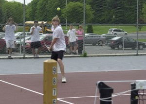 Naugatuck's No. 1 player, Tim Simons, prepares to uncork a two-handed backhand during his match against Torrington's Steve Consolini Monday. Simons broke Consolini's serve in the game to take a 4-3 lead but lost the match, 8-4.