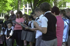 Students from St. Francis of Assisi School read a series of prayers, whose subjects included government, family and education.