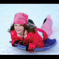 Hannah Broniewski, 9, sleds at Fairchild Park after the snow storm Dec. 27.