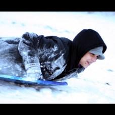 Jordan Abraham, 12, sleds at Fairchild Park after the snow storm Dec. 27.