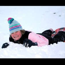 Rebecca Rushworth, 11, sleds at Fairchild Park after the snow storm Dec. 27.