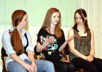 """From left, Sophomore Stephanie Hensley, playing Kate, junior Erica Blasko playing Juliet, and junior Danielle Wicks, playing Cordelia rehearse a scene for the drama club play """"Ladies Sigh no More."""""""
