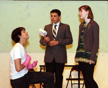 """From left, freshman Troy Bond, as Jamison, freshman Preston Bogan, playing Dr. Wells, and Sophomore Chelsea Newman, playing Lady Ann, rehearse a scene for the high school production of """"Ladies Sigh no More."""""""