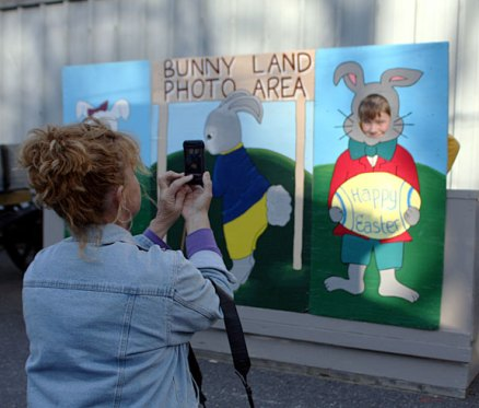 Denise Petelle, left, takes a picture of her son, Evan Petelle, 7, as a bunny at the Naugatuck Parks and Recreation Department's Easter Village April 22.
