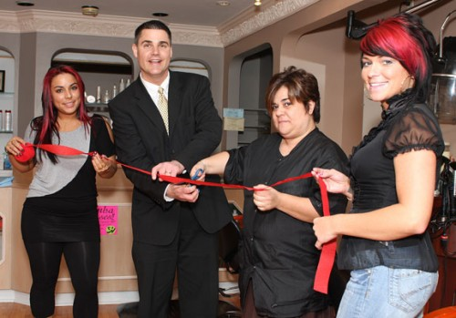From left, receptionist Ashley Rodrigues, Naugatuck Mayor Bob Mezzo, salon owner Christine Rodrigues, and stylist Carly Stotz cut the ribbon to signify the opening of Maxim Salon at 26 Church Street in Naugatuck. The salon opened March 4 and offers hair styling, tanning, waxing, natural nails, and eyelash tinting.