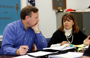 Finance Chair Chris Bielik,left, discusses cuts to the proposed budget with Finance Board member Wendy Hopkinson following Tuesday night's public budget hearing.