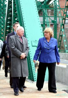 State. Sen. Joe Crisco (D-Woodbridge), left, and Beacon Falls First Selectman Susan Cable walk across the newly renovated Depot Street Bridge April 8.