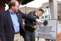 Selectman Michael Krenesky, left, admires a plaque commemorating the dedication of the Depot Street Bridge, along with Paul Block.