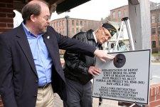 Selectman Michael Krenesky, left, admires a plaque commemorating the dedication of the Depot Street Bridge, along with Paul Block.