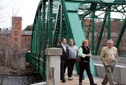 Attendees of the dedication walk across the refurbished Depot Street Bridge April 8.