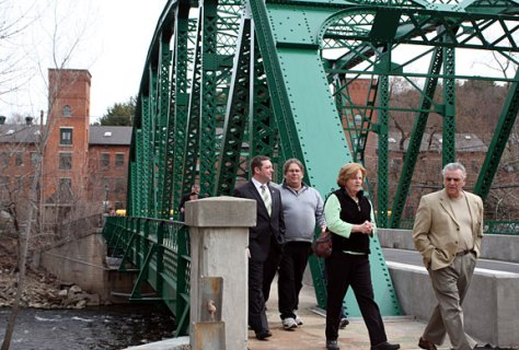 Attendees of the dedication walk across the refurbished Depot Street Bridge April 8.