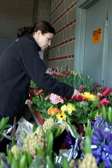 Lauren Greatorex of Woodbury shops for flowers at the Naugatuck Fire Department's flower sale April 21. The Fire Department raises funds for local charities.