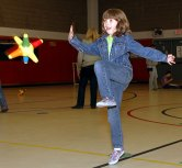 """Lindsey Schulte, 8, plays """"Catch a Run."""" Each point of the star-shaped ball has a number that students had to add up."""
