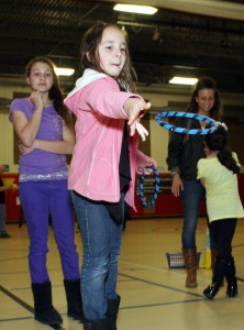 "Emily Dyer, 9, tries to ""Ring a Run"" at Maple Hill math night."