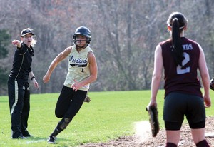 Woodland's Lindsay Boland rounds third on her way to an inside the park homerun on Monday versus Naugatuck. The Hawks topped the 'Hounds 15-8. -LARAINE WESCHLER