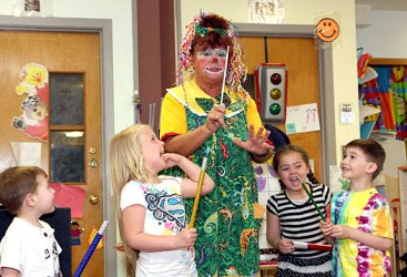 From left, Christina Roberts, Sparkles the Clown, Jade Lockwood, and Joey Spina hold out their magic wands.