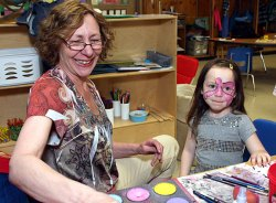 Local artist Nancy Haack paints a bird on Kayleanna Michaels, 4, a Headstart student at Prospect Street Preschool. Haack donated her time talent to give all the Headstart students a special treat. She will also give free face painting to Headstart students at her Duck Day booth.