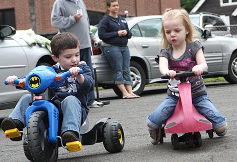 James Korowotny, left, and Alivia Stewart trike around the parking lot of Tender Years Preschool in Naugatuck during the annual Trike-a-Thon May 20.