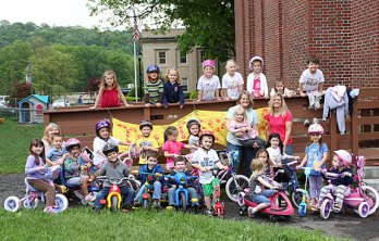 The Tender Years Preschool class poses in with their tricycles during the annual Trike-a-Thon May 20 in Naugatuck..