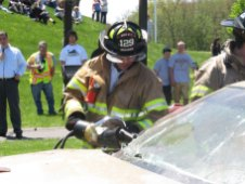 KYLE BRENNAN Woodland student Cal Brennan works to cut apart one of the cars used in a mock crash May 11. Brennan organized the mock crash for his senior project.