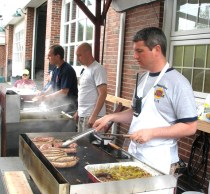 Jeremy Rodorigo, public information officer for the Beacon Hose Co. No. 1, mans the grill during the 4th annual Naugatuck Valley River Race and Festival May 7. PHOTO BY ELIO GUGLIOTTI