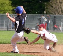 Naugatuck's Brian Pihonak tags his Crosby opponent out during the Hound's game May 9. - PHOTO BY LARAINE WESCHLER