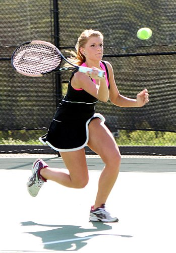 Woodland's Lauren Temaglio battles it out on the tennis court during the Hawk's match against Watertown May 9. - PHOTO BY LARAINE WESCHLER
