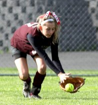 Naugatuck's Melissa LaBonte goes for a grounder during the Hound's match against Crosby May 9.