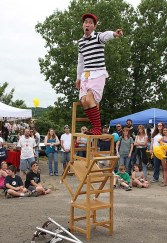 Rob Lok, top, with Cirque Du Jour, performs at Naugatuck Duck Day June 5.