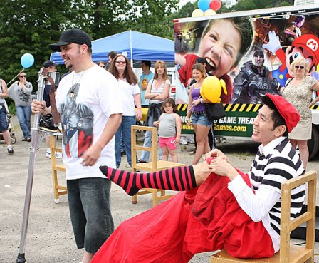 Rob Lok, right, with Cirque Du Jour, performs with the help of Dave Alvarez at Naugatuck Duck Day June 5.