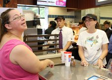 Western Elementary School teacher Michelle Baker, right, takes an order from Blenda Ellingson, mother of a student at the school, during Teacher's Night at McDonalds on Rubber Avenue in Naugatuck. Ten teachers worked at McDonald's from 5-8 p.m. June 2 to raise money for the school. Ten percent of sales will be donated to the school.