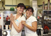 Western Elementary School teacher Heather MaKarewicz, left, and school psychologist Liliana Felix, right, take a break from serving drinks for a photo op during Teacher's Night at McDonalds on Rubber Avenue in Naugatuck. Ten teachers worked at McDonald's from 5-8 p.m. June 2 to raise money for the school. Ten percent of sales will be donated to the school.