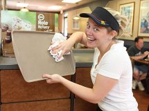 Western Elementary School teacher Erica Mulhall cleans a tray during Teacher's Night at McDonald's on Rubber Avenue in Naugatuck. Ten teachers worked at McDonald's from 5-8 p.m. June 2 to raise money for the school. Ten percent of sales will be donated to the school.
