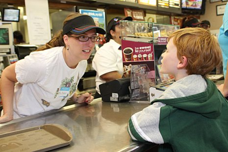 Western Elementary School teacher Michelle Baker, left, takes an order from Gabriel Sidoti, 8, a student at the school, during Teacher's Night at McDonald's on Rubber Avenue in Naugatuck. Ten teachers worked at McDonald's from 5-8 p.m. June 2 to raise money for the school. Ten percent of sales will be donated to the school.