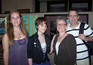From left, Jenna McLaughlan, Erin McLaughlan, artist and Holy Cross High School Student, Anne McLaughlan and Ben McLaughlan attend the Naugatuck Historical Society's art show Saturday. -CONTRIBUTED