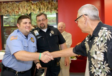 Tim McDevitt, right, thanks Thomas Dempsey, left, and Peter Johnson, center for their role in saving his life.