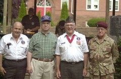 From left, Tony Saranbrea, Leonard Romaniello, Col. John Chiarella of the Waterbury Veterans Memorial Committee, and Chaplin Charles B. Hagearty of the Naugatuck Capital War Veterans. ELIO GUGLIOTTI