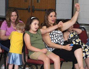 Alexus Martin, 7, left, and Margarida Rodrigues participate in Les Julian's children's concert, We All Laugh in the Same Language, July 7 at the Prospect Fire House. The concert was hosted by the Prospect Public Library.