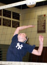 Emma Healy, 12, spikes the ball at the Parks and Recreation Department sponsored volleyball camp at Naugatuck High School July 14.