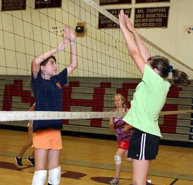 Katheryn Healy, 12, left, and Nicole Healy, 12, match up at the Parks and Recreation Department sponsored volleyball camp at Naugatuck High School July 14.