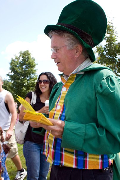 Mayor Robert Chatfield as the Mayor of Emerald City from the Wizard of Oz, hands out fliers during character day at End of Summer Fun Week on the Prospect Town Green Aug. 22. The day featured face painting, train rides, and ice cream.