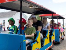 Children enjoy a train ride during End of Summer Fun Week on the Prospect Town Green Aug. 22. Monday was character day and featured face painting, train rides, and ice cream.