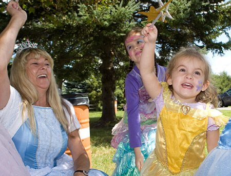From left, Cher Brooks, Elizabeth Miller, 6, and Rebeca MIller, 3, share star power during character day at End of Summer Fun Week on the Prospect Town Green Aug. 22. The day featured face painting, train rides, and ice cream.
