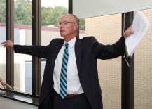 David King of Kaestle Boos Associates gestures at windows that come loose from the walls during an Aug. 25 tour of Naugatuck High School. King said the problem is indicative of classrooms through the building.