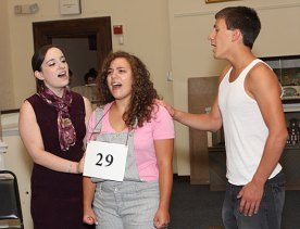 From left, Colleen Gunning, Tessa Newell, and Jeff O'Brien rehearse 'Spelling Bee' Monday night for their performances at the Naugatuck Historical Society this weekend.