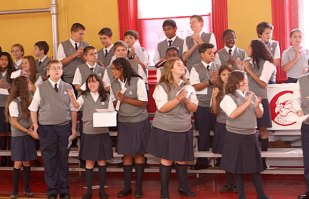 St. Francis-Hedwig School students cheer during a ceremony blessing the new Naugatuck school Wednesday morning.