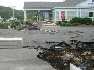 Tropical Storm Irene further damaged the entrance to Mountview Plaza and Webster Bank from Rubber Avenue, but a lawyer representing the company that owns the shopping center said they could begin fixing it within the month.  - RA ARCHIVE
