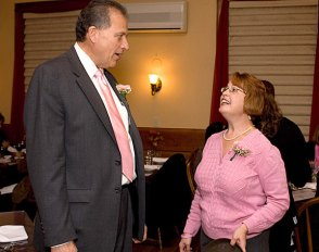 """Naugatuck Savings Bank President and CFO Chuck Boulier chats with Naugatuck Rotary Club President Jennifer Merrill during the """"Waiters go Pink"""" fundraiser at Jesse Camilles Restaurant Monday night."""
