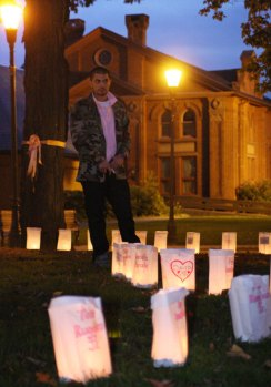 Thomas Bepko listens to a ceremony Monday night on the Town Green to kick off The Valley Goes Pink month.