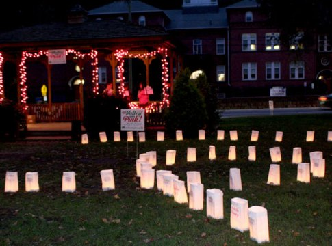 Luminaries honor cancer survivors and victims Monday night on the Town Green to kick off The Valley Goes Pink month.